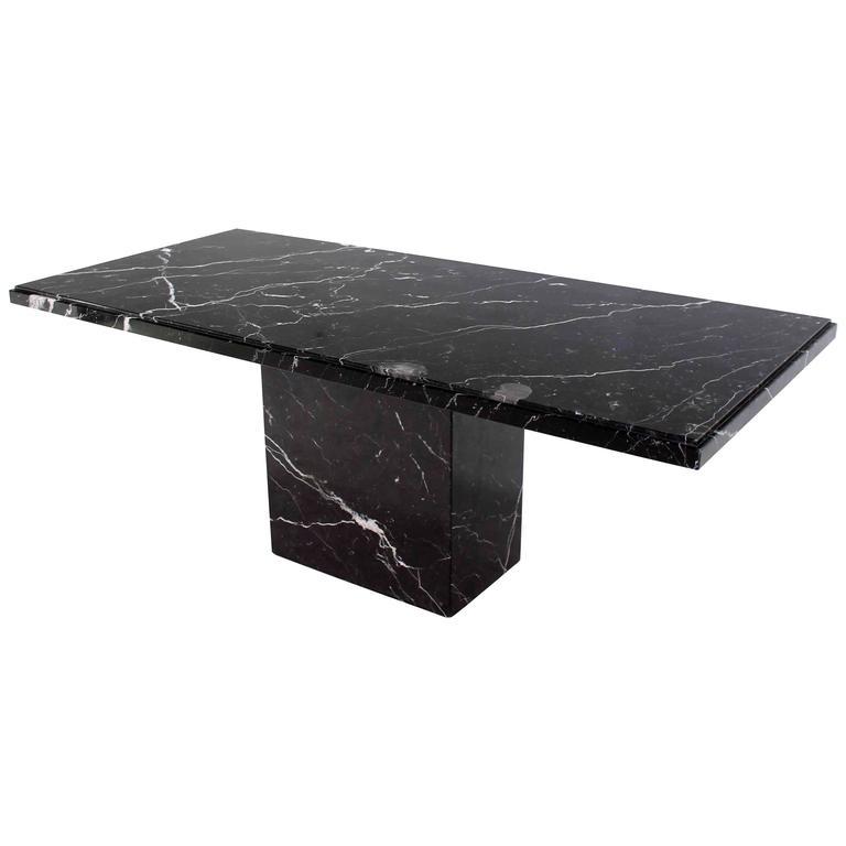 single pedestal black marble