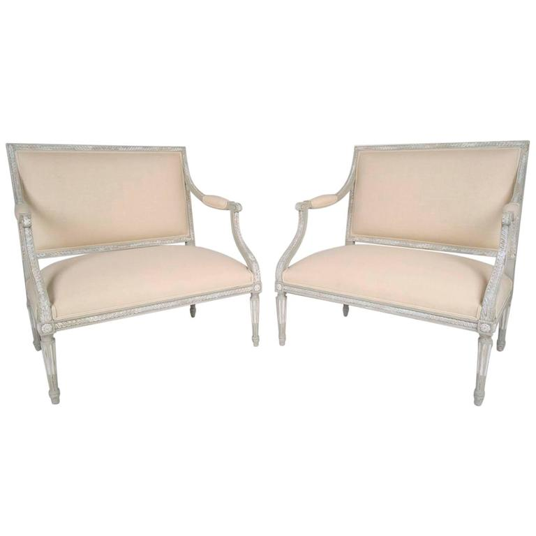Pair Of Antique French Louis XVI Wide Seat Arm Chairs For Sale