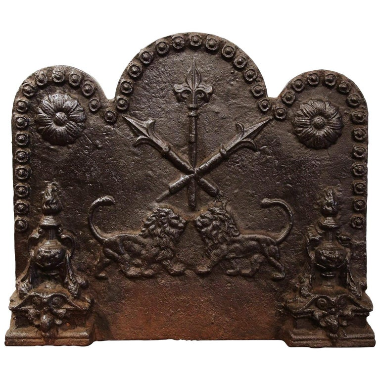18th Century French Wrought Iron Arched Fireback with Lion and Spear Decor For Sale