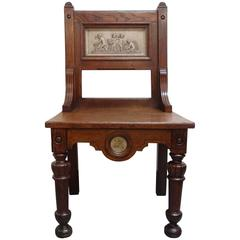 Arts and Crafts Gillows oak hall chair with putti plaster panels circa 1880s