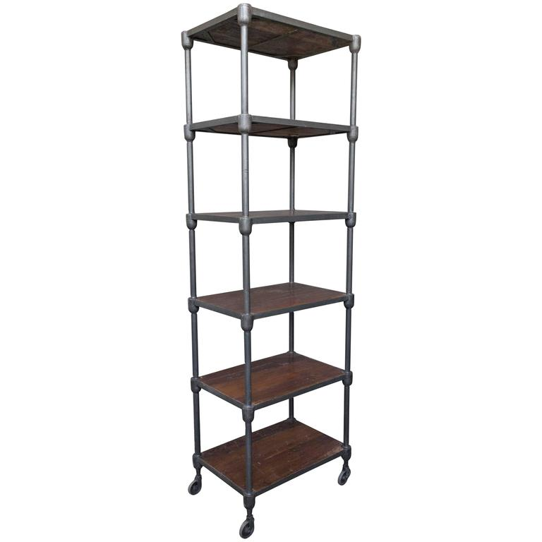 tall wood and metal industrial shelving unit on casters at. Black Bedroom Furniture Sets. Home Design Ideas