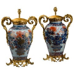 Pair of late 19th century Oriental Porcelain Ovoid Vase Lamps