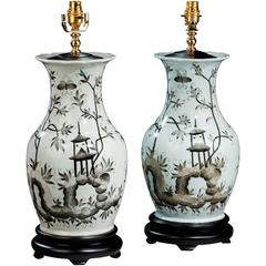 Large Pair of Ebonized Painted Lamps