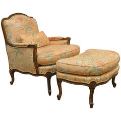 1950s French Country Louis XV Style Shell Carved Bergere Armchair and Ottoman