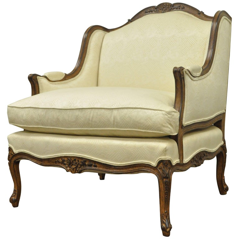 Vintage Wide Frame French Country Louis XV Style Floral Carved Bergere Arm Chair For Sale