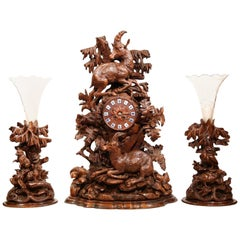 19th Century Swiss Black Forest Carved Walnut Clock with Matching Vases