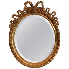Pretty Oval Carvers Guild Louis XVI Giltwood Mirror