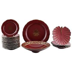 Collection of 'Red Rubin' Pottery with Red Glaze with Gold, Upsala-Ekeby, Gefle