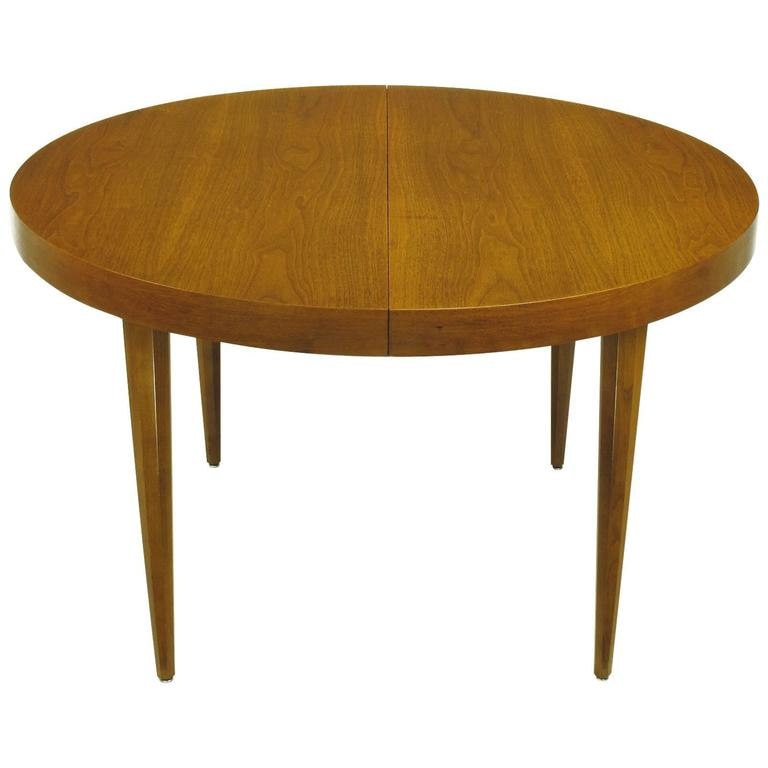 sleek modern walnut dining table in the style of t h robsjohn