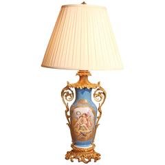 French Sèvres Porcelain Lamp in Celeste Blue with Hand-Painted Reserves