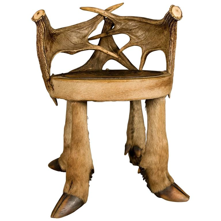 Moose Antler Stool With Pierced Wooden Seat On Four Moose