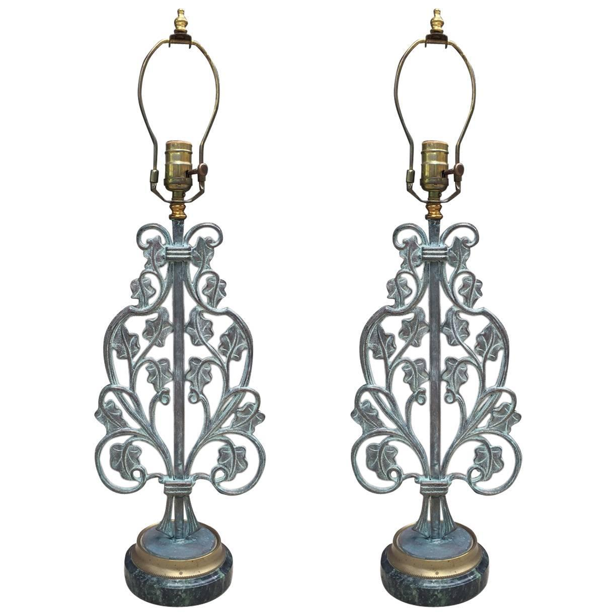 pair of wrought iron lamps on marble and bronze base. Black Bedroom Furniture Sets. Home Design Ideas
