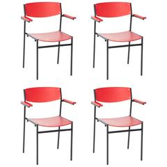 Set of four GIJS VAN DER SLUIS Sluijs red industrial armrest chairs