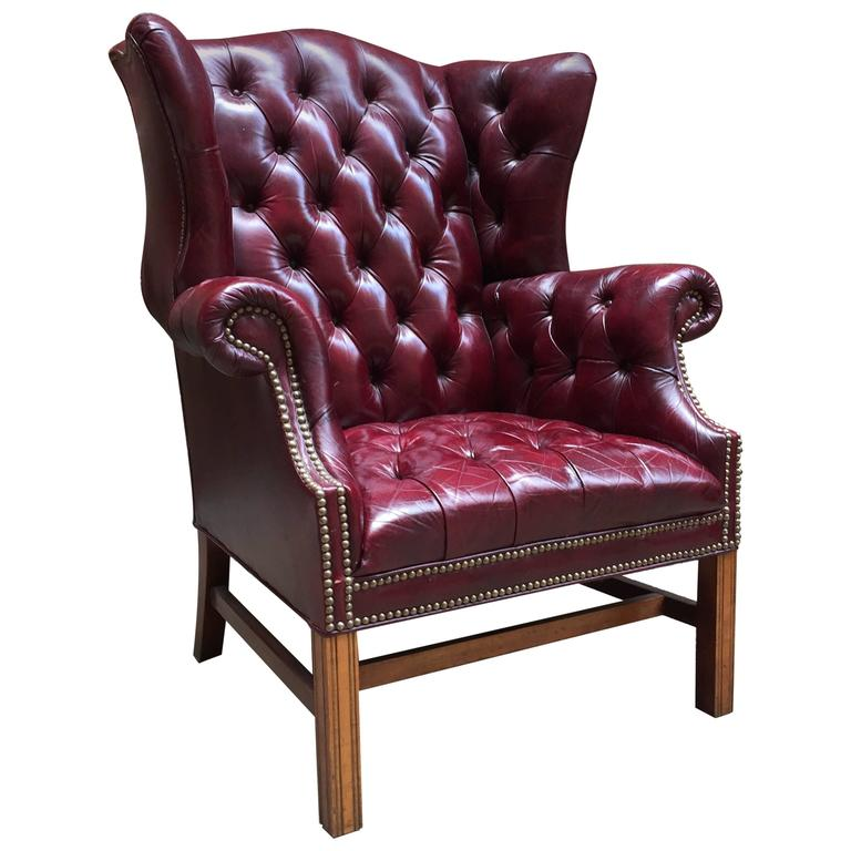 Cordovan leather chesterfield tufted wing chair for sale at 1stdibs