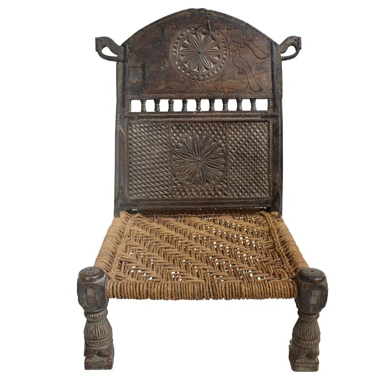 Antique Afghan Chieftain Ceremonial Hand-Carved Chair with Woven Rope Seat  For Sale - Antique Afghan Chieftain Ceremonial Hand-Carved Chair With Woven