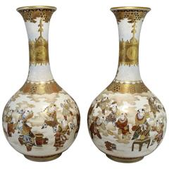 Pair of Late 19th Century Japanese Satsuma Vases with Figural Decoration