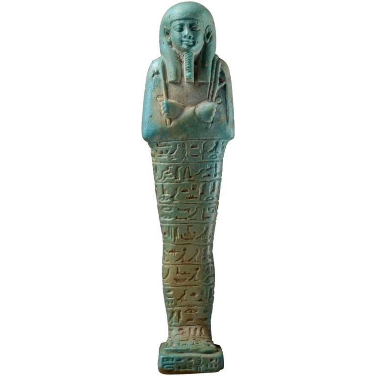 egyptian shabti funerary figures It's a shabti, a funerary figure that would have been entombed with the mummified body this one is, i think, a modern copy, probably sold to tourists on a nile cruise, but it is made of the same rough earthenware and faience glaze as the originals.