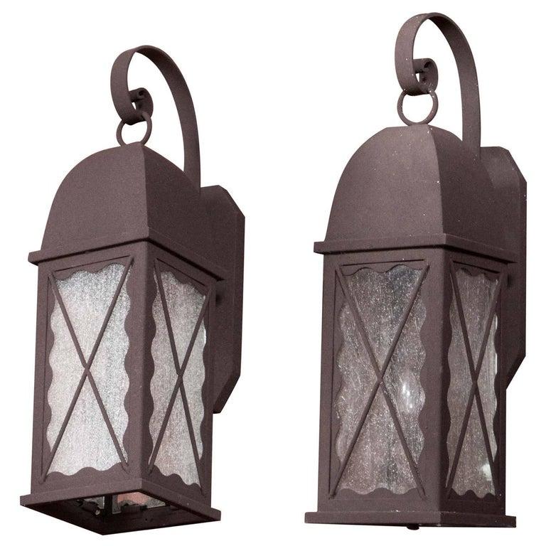 Pair of Iron Exterior Lantern Sconces For Sale