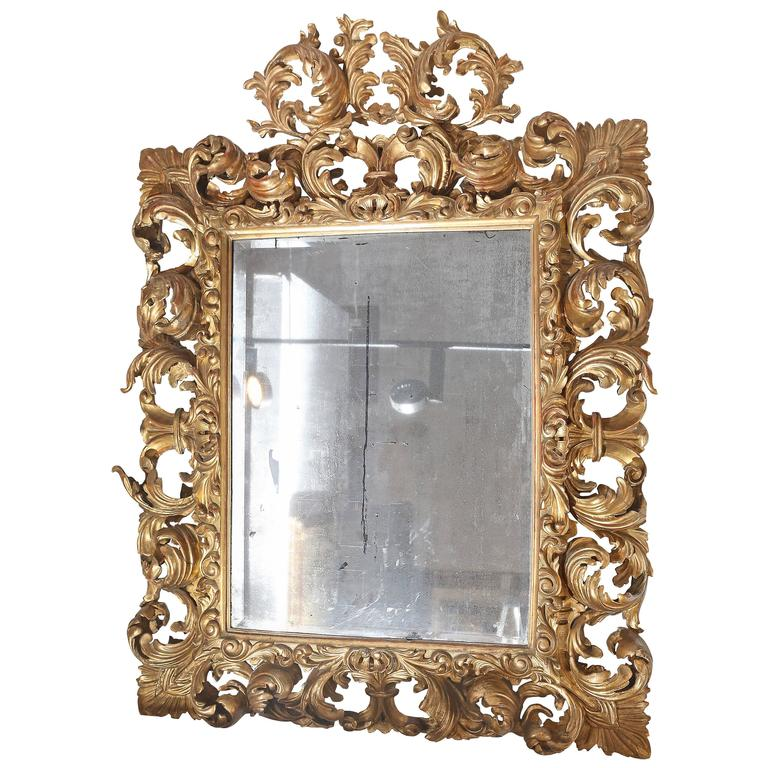 Heavily carved and gilt italian baroque mirror for sale at for Italian baroque mirror