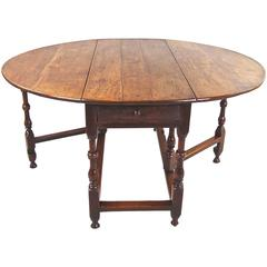English Late 17th Century Oak Drop-Leaf Table with Drawer