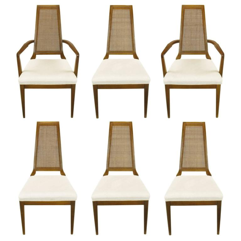 Sleek, circa 1950s Modern Walnut and Cane Dining Chairs For Sale