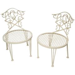 Pair of Mid-Century Modern Hollywood Regency Chairs in the Style of Rene Prou