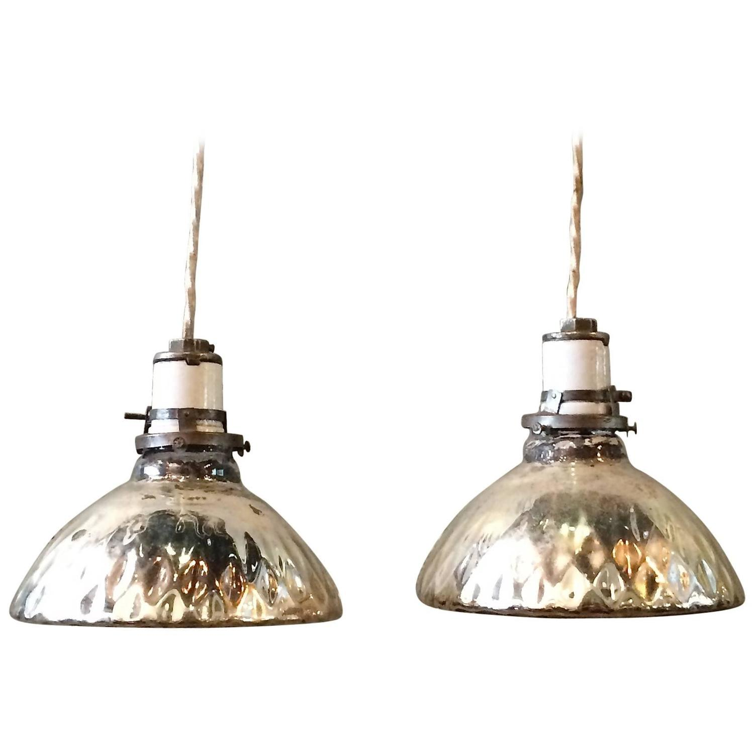pair of silver quilted mercury glass pendant lights
