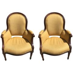 Pair of Early 19th Century French Walnut Bergere Chairs