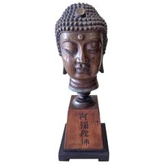 Chinese Bronze Buddha Head on a Wood Flat Top Pyramid Stylized Base
