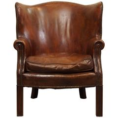 Antique English mahogany leather library chair