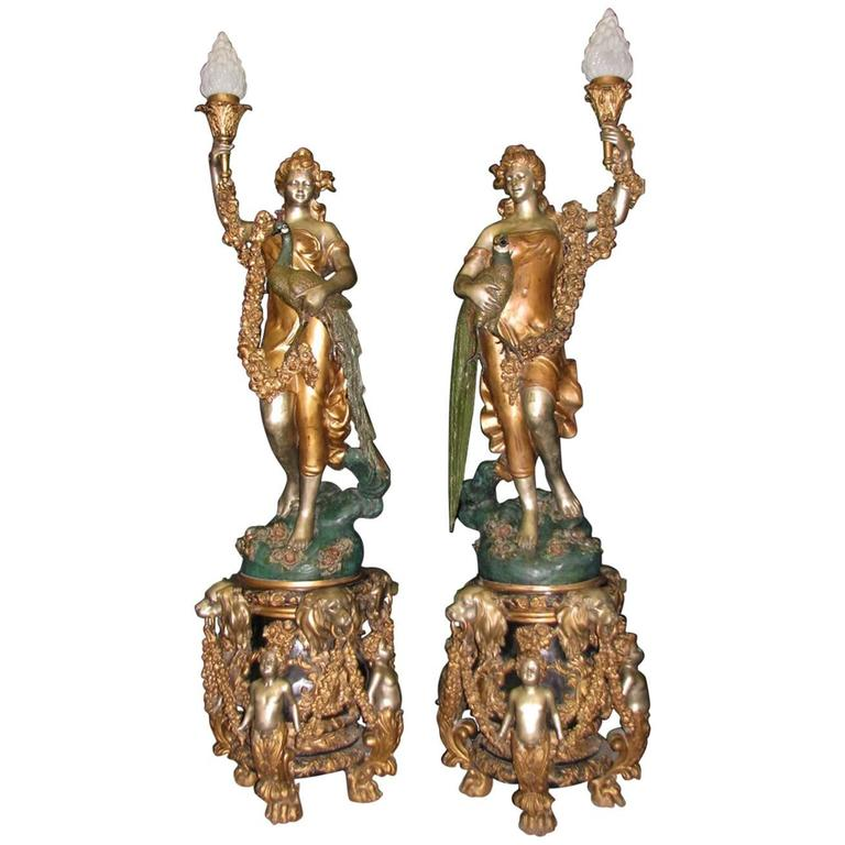 Monumental Pair of Patinated Bronze Torchiere Signed