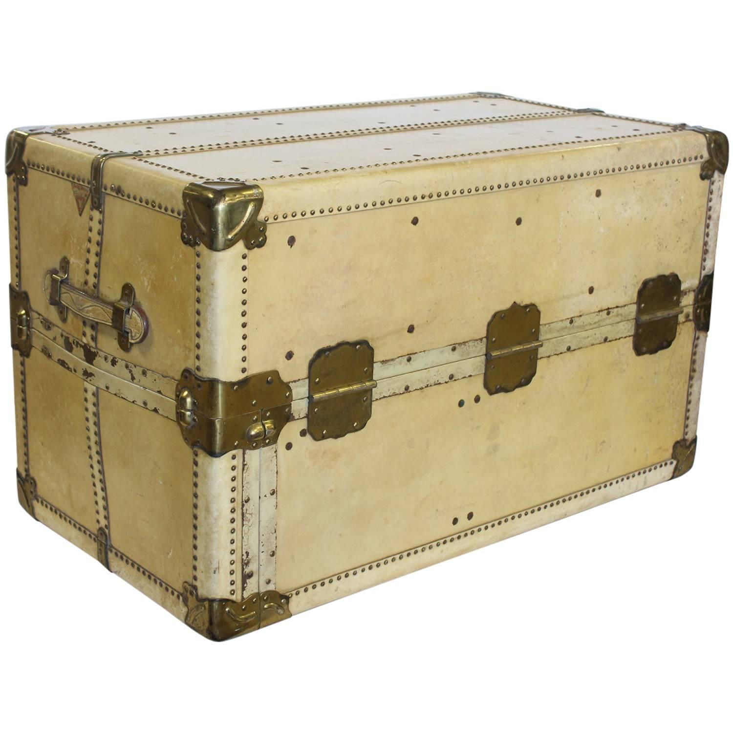 Stylish Antique Vellum Steamer Trunk Coffee Table For Sale