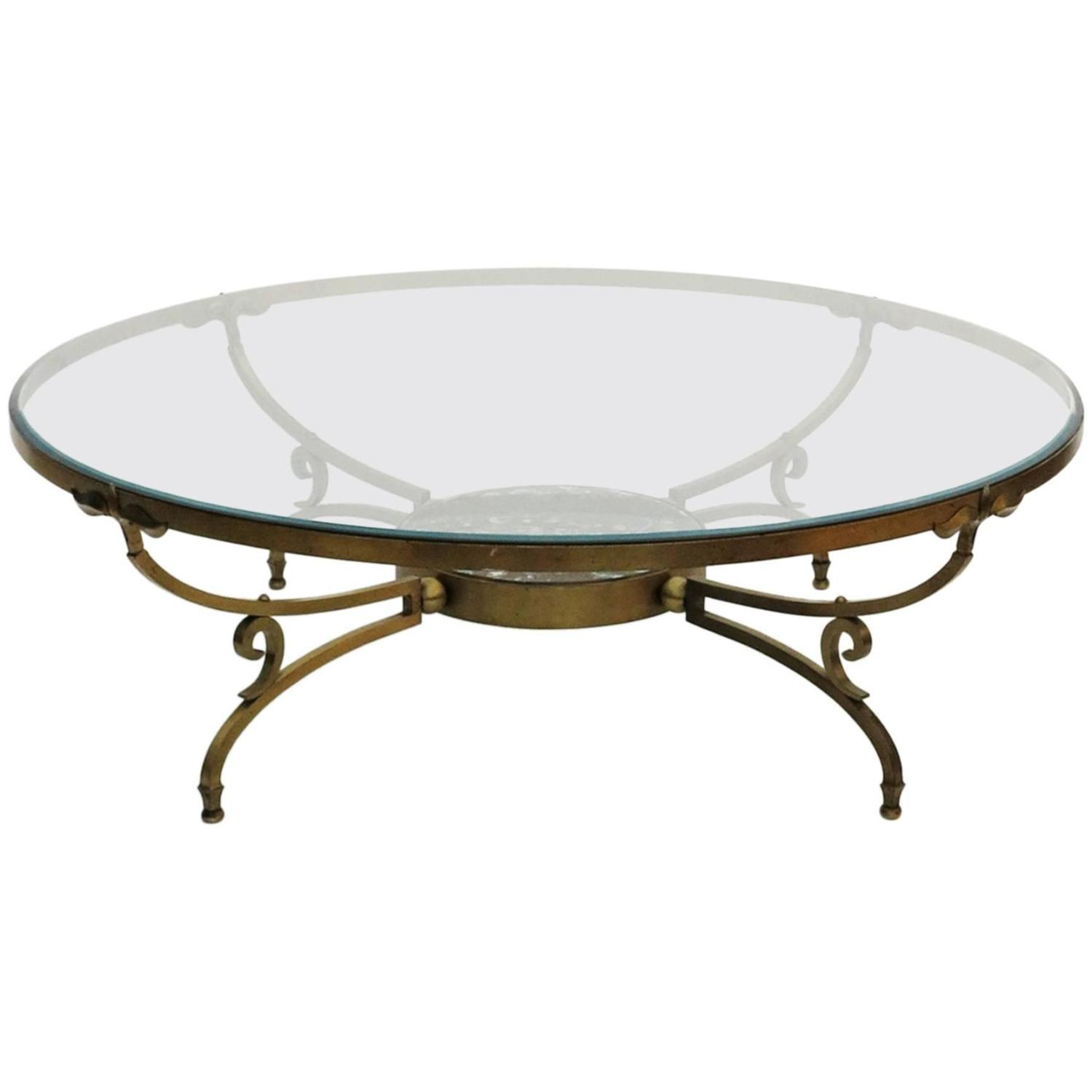 Round bronze and glass coffee table by arturo pani at 1stdibs geotapseo Images