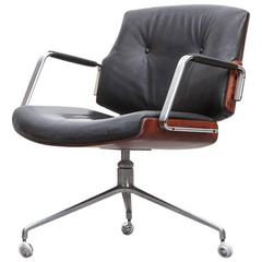 1960's brown wood and black leather Swivel Chair by Fabricius and Kastholm 'e'