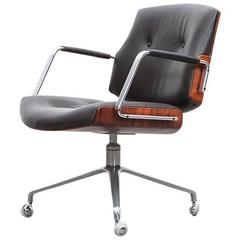 1960's brown wood and black leather Swivel Chair by Fabricius and Kastholm 'd'