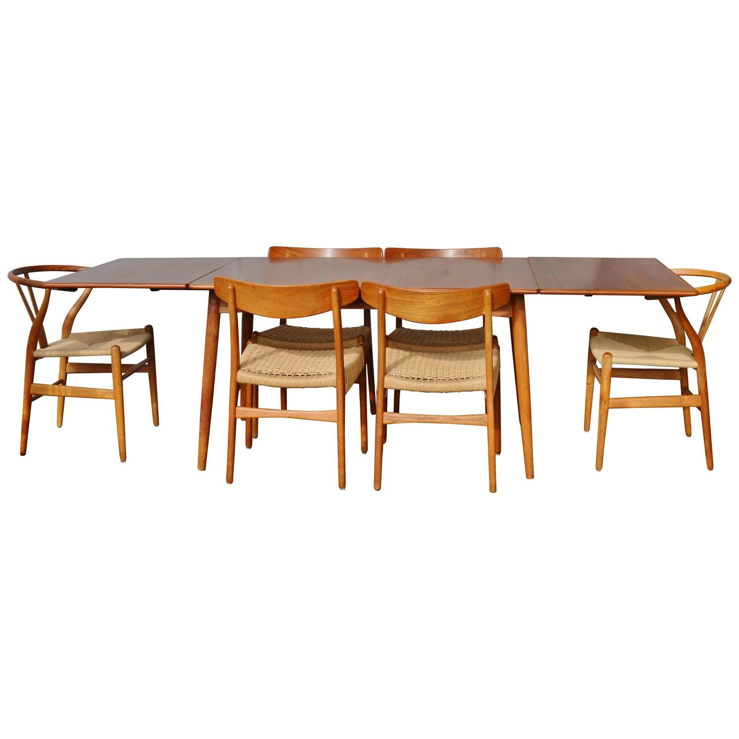 Impeccable Quality Hans Wegner Drop-Leaf Dining Table with Six Chairs at  1stdibs