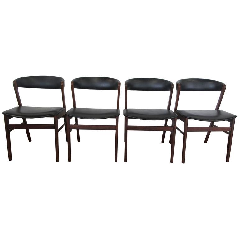 Set of Four Kai Kristiansen Rosewood Chairs Upholstered in Black Naugahyde