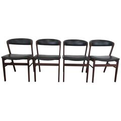 Set of Four Kai Kristiansen Rosewood Chairs Upholstered in Black Naugahyde