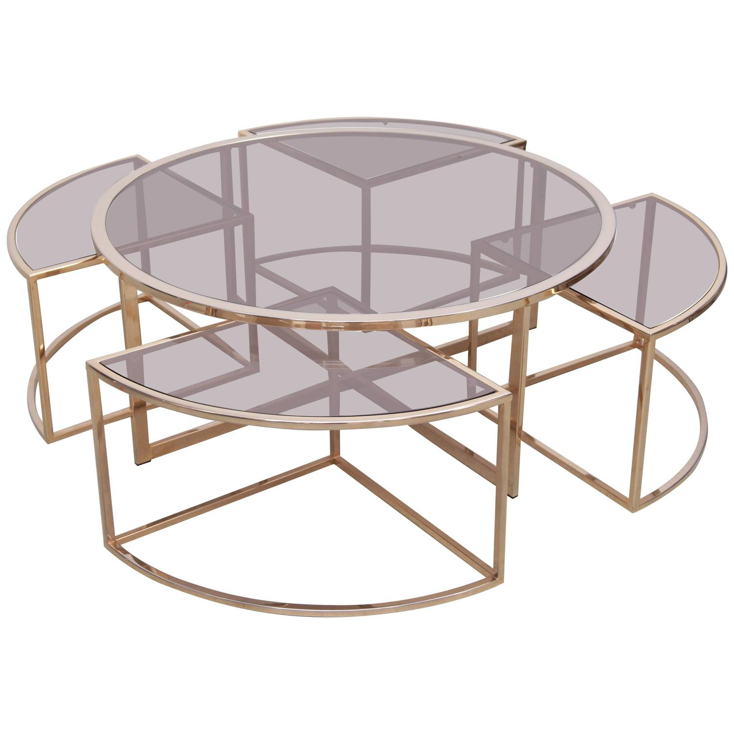Round brass coffee table with four nesting tables by maison charles at 1stdibs Brass round coffee table