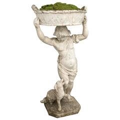 Statue of a Boy Holding a Planter Basket