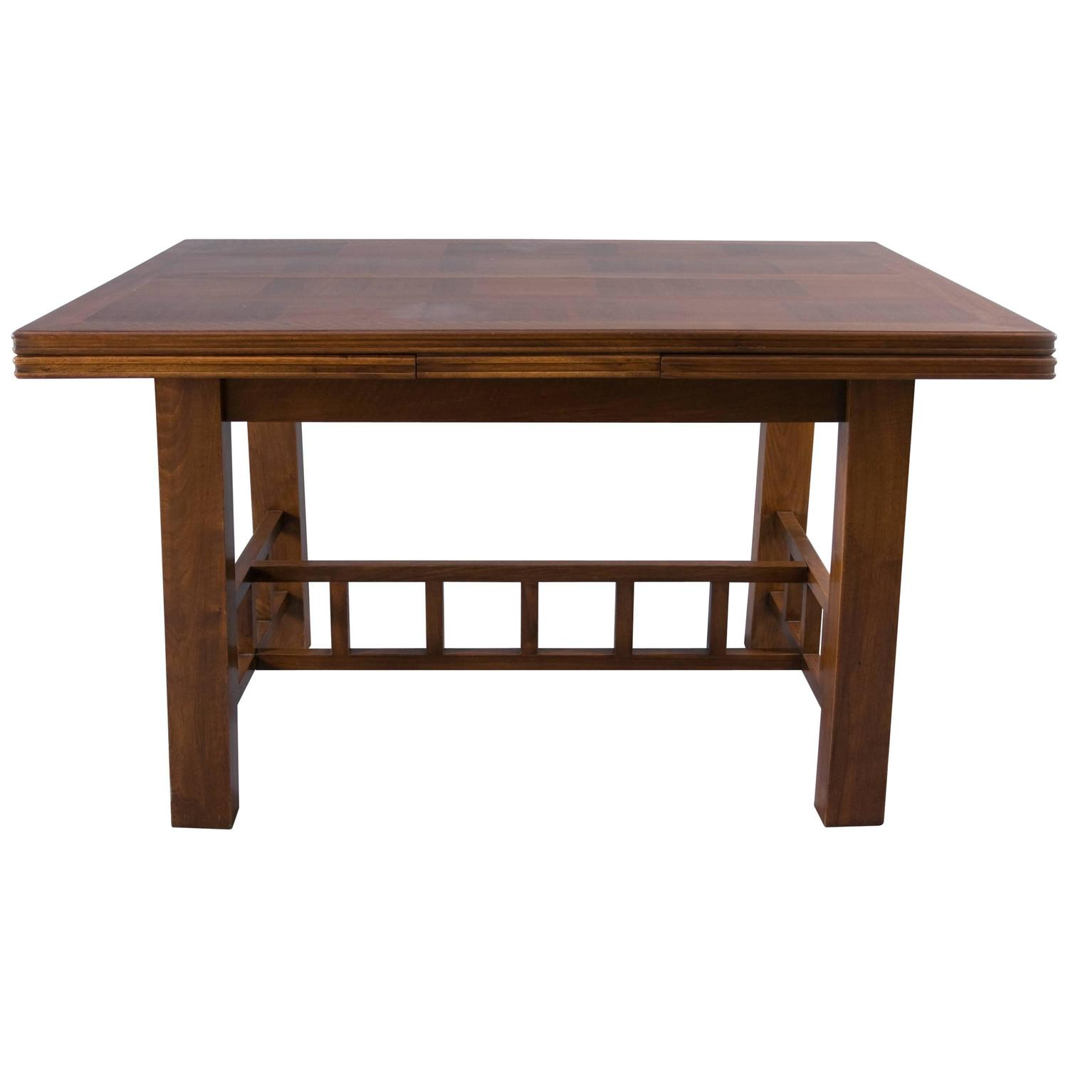 dining table with extension leaves attributed to francis