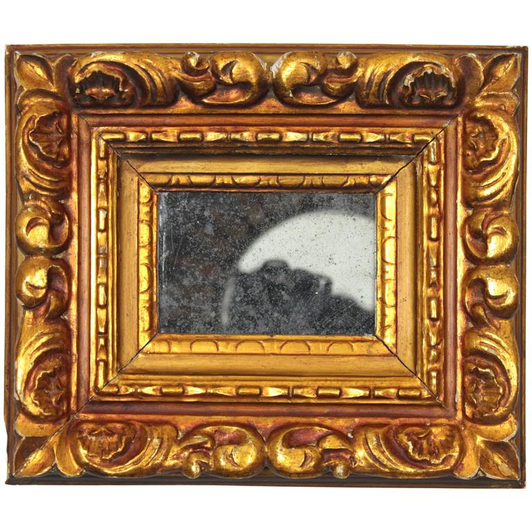 Small baroque style carved giltwood mirror spain circa for Small baroque mirror