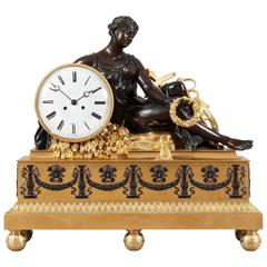 Grand French Gilt and Patinated Bronze Mantel Clock in the Empire Style