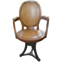 Empire Leather and Oak Swivel Chair