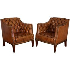 Pair of French Mahogany and Tufted Leather Upholstered Bergeres