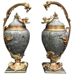Pair of French Ormolu-Mounted Marble Urns with Cherubs