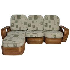 "Paul Frankl Designed Rattan ""Pretzal"" Four-Piece Sofa and Ottoman with Cushions"