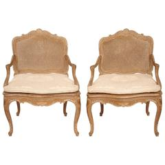 End of 19th Century Pair of Louis XV Style Natural Wood Caned Armchairs