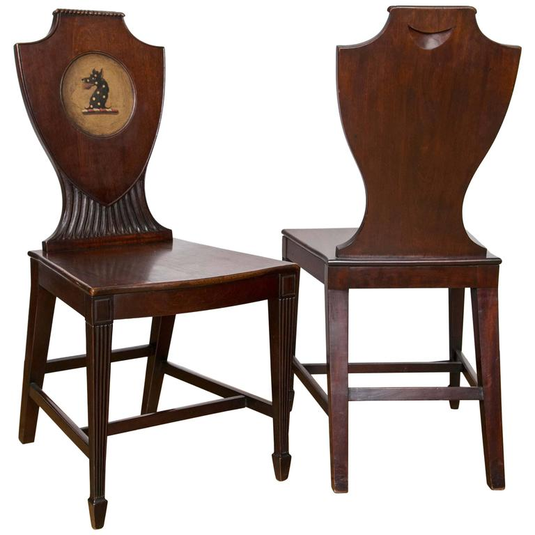 Pair of English Regency Era Painted Mahogany Hall Chairs For Sale