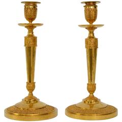 Pair of Early Empire Gilt Bronze Candlesticks